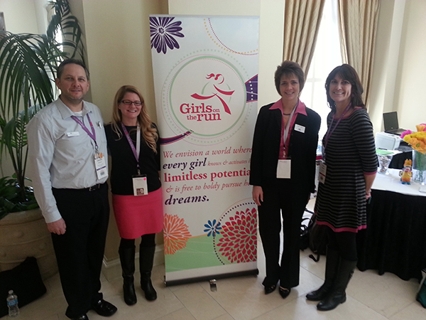 The 2014 Girls on the Run (GOTR) Summitt. From left to right: Dennis Johnson, VP of Advisory Services of Forward Community Investments, Sara Pickard, Executive Director, GOTR of Dane County, Mary Stelletello, Principal, Vista Global Coaching & Consulting, and Mindi Giftos, Board Chair, GOTR of Dane County.